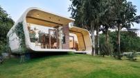 Ngôi nhà mang cấu trúc bê tông cong ấn tượng