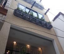 Bán Gấp nhà HXH trung tâm Tân Bình 45m2 2 tầng 0932998521.
